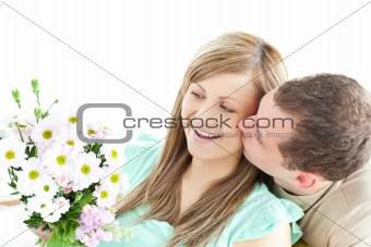 Enamored man giving a bouquet to his girlfriend