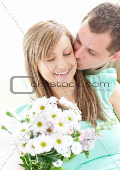 Loving man giving a bunch of flowers to his girlfriend