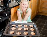 Smiling housewife preparing cookies