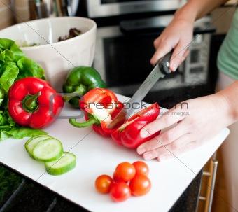 Close-up of a beautiful woman preparing a salad