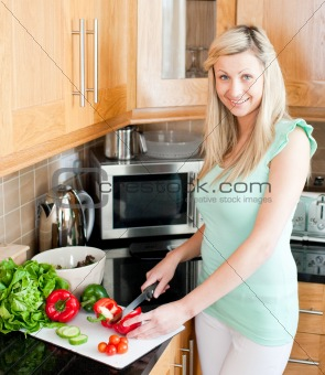 Beautiful woman preparing a salad