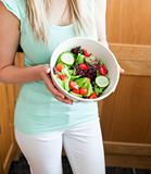 Beautiful woman showing a salad