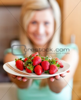 Positive woman showing fruits