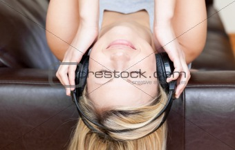 Calm woman using headphones