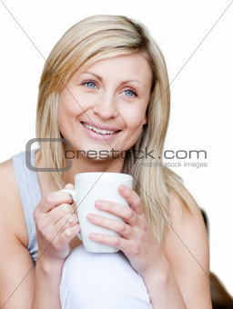 Attractive woman holding a cup of coffee