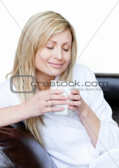 Cute woman holding a cup of coffee