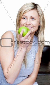 Beautiful woman eating an apple