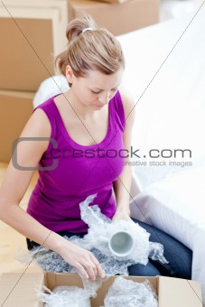 Caucasian woman unpacking box