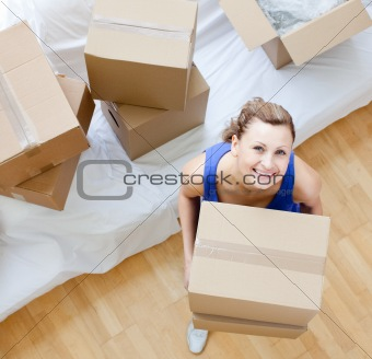 Bright woman holding a box