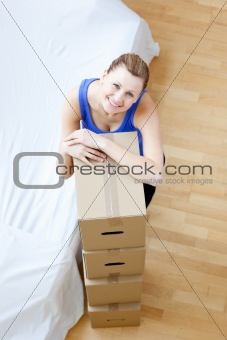 Attractive woman is moving various boxes