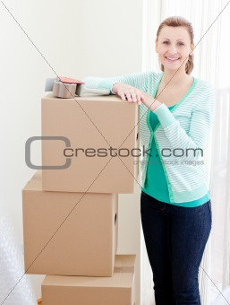 Beautiful woman closing various boxes