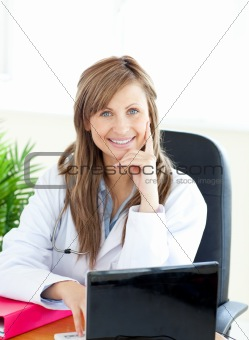 Attractive female doctor working with a laptop