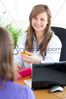 Bright female doctor holding medicine