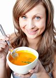 Cute woman holding a soup bowl 