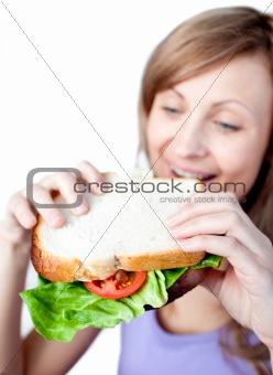 Caucasian woman holding a sandwich