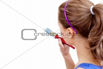 Caucasian woman using a paintbrush
