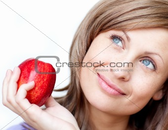 Bright woman holding an apple