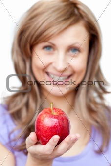 Attractive woman holding an apple