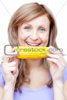Beautiful woman holding a corn