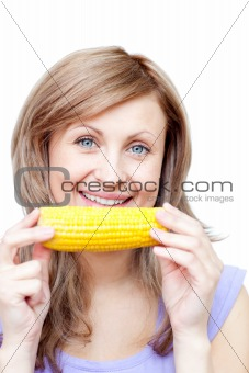 Attractive woman holding a corn