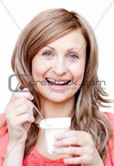 Beautiful woman eating a yogurt