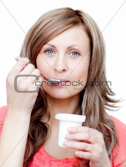 Attractive woman eating a yogurt