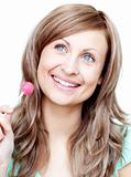 Delighted woman holding a lollipop