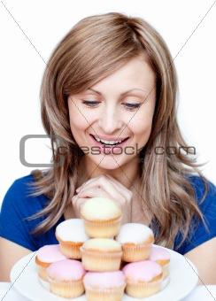 Cute woman eating a cake