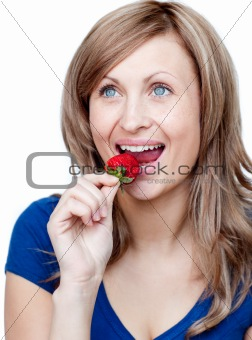 Bright woman eating strawberries