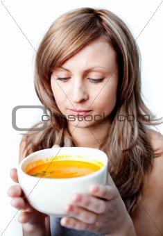 Beautiful woman holding a soup bowl