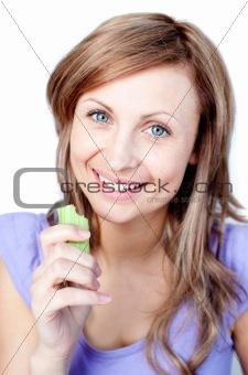 Beautiful woman eating celery
