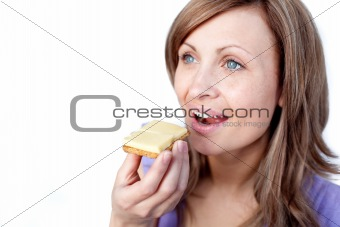 Attractive woman eating a cracker with cheese