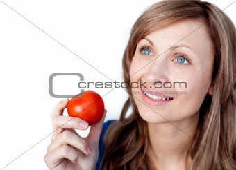 Positive woman holding a tomato