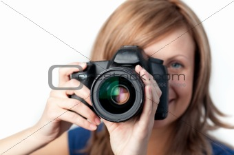 Attractive woman using a camera