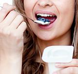 Close-up of a woman eating a yogurt
