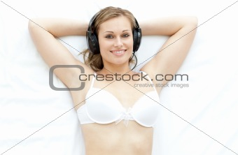 Attractive woman in underwear listening music