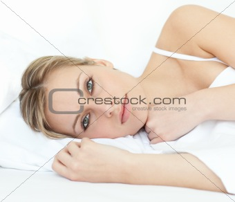 Charming woman relaxing in a bed