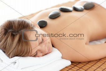Bright woman having a stone therapy