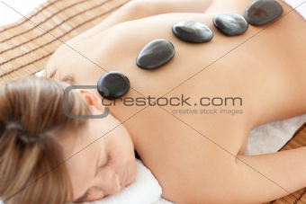Bright woman lying on a massage table