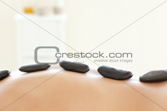 Caucasian woman lying on a massage table