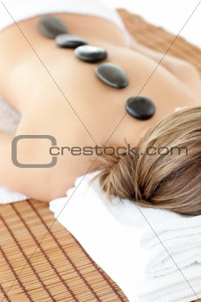 Sleeping woman lying on a massage table