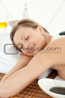 Portrait of a happy woman having a massage with stones