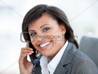 Attractive businesswoman using a mobile phone