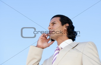 Portrait of an handsome business man using a cellphone