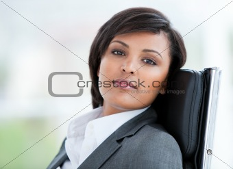 Portrait of a brunette business woman at work