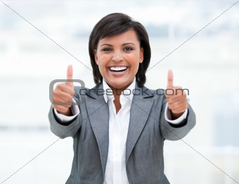 Portrait of a successful business woman with thumbs up