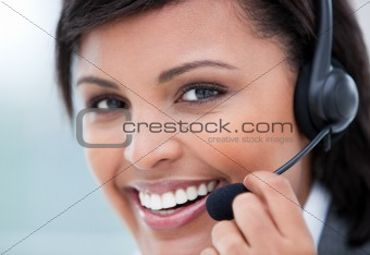 Self-assured Customer service representative using headset in the office