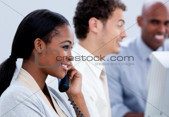 Positive Afro-American businesswoman talking on phone