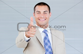 Cheerful businessman with a thumb up