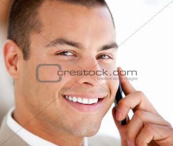 Portrait of a serious businessman on phone